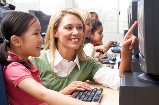 Teacher helping kindergarten children